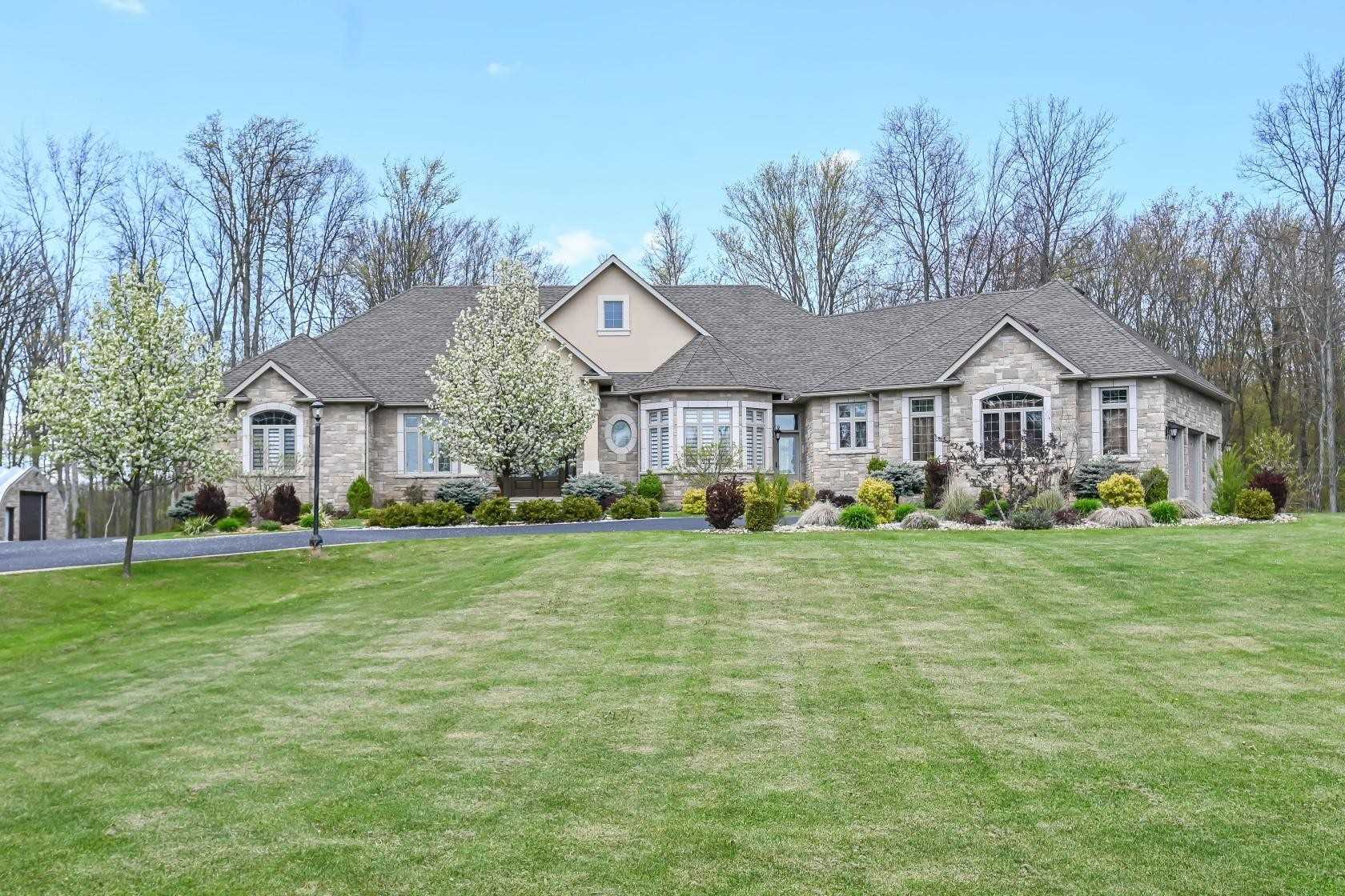 10 Mins From City! 3468Sqft Custom Built Bungalow Nestled On Apprx 25 Total Acres Of Landscaped Grounds W/Multiple Acres Of Treeline & Bush. 6300Sqft Of Finshd Livng Space. Trple Car Grg On Side, Natural Light From Frnt To Back, Ceramic Tile & Views Of Bckyrd Over Formal Dining Rm. Hardwd Flrs W/Custom Trimwork & Crwn Mldng Arnd 10Ft Ceils. Master W/Frnch Drs, 2 W/I Clsets, 6Pc Ensuite & W/O To Rear Porch. O/C E/I Kitchen W/Granite Isl, Bay Wdw In Brkfst. Rsa