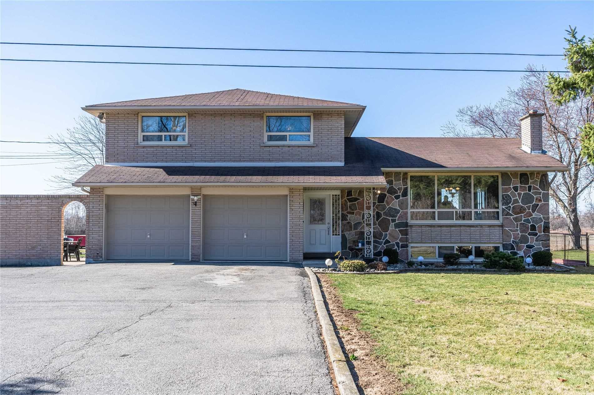 This 3 Bdrm, 2 Bthrm Side Split W/Detached Garage & Oversized Shop Is Well-Loved & Cared For. Step Into The Beautifully Tiled Front Door, Down To A Large Pantry & Enlarged Family Rm W/Gas Fireplace. Up The Steps, You Are Greeted With A Large Front Window In The Living Room Featuring A Wood Fireplace. The Dining Room & Custom Kitchen Is A Great Place For The Family To Gather In The House. Upstairs There Are 2 Lrg Bdrms Both W/Closets & Lrg Primary W/Walk In.