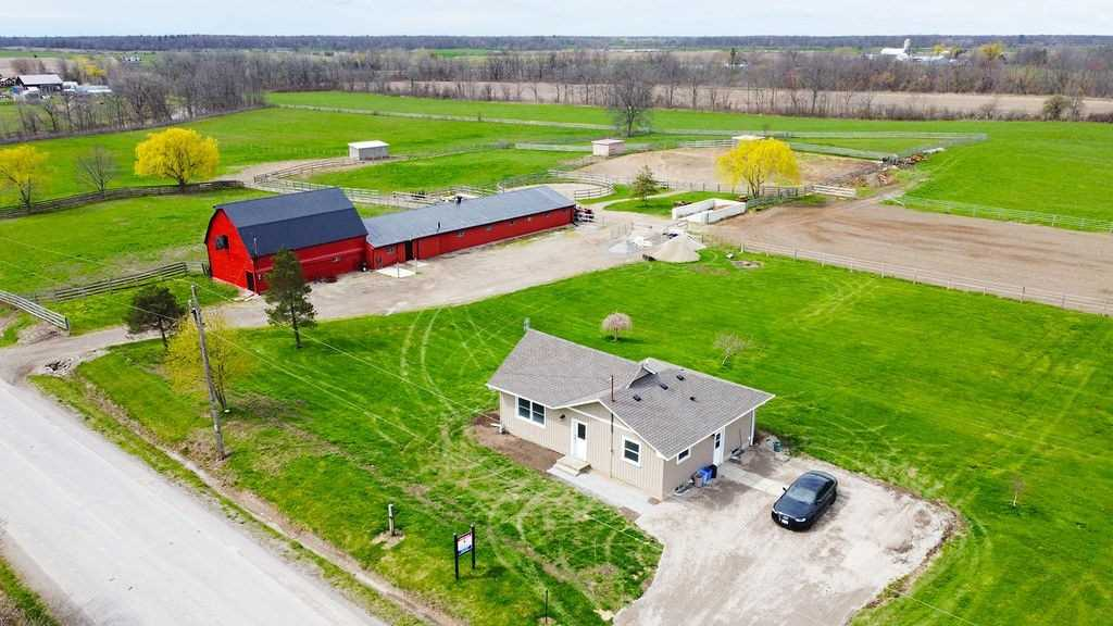 Rolling 34+ Acre Property Complete W/Updated Bungalow W/Vaulted Ceiling & Loft Area, Eat-In Kitchen W/Island, Maple Cabinets And Floors, 15 Stall 30 Ft X 100 Ft Horse Barn Connected To An Additional 28 Ft X 40 Ft Barn W/Tack Room, Work Bench Area & Hay Loft. This Is A Beautiful Package W/ 2 Road Frontages & Has An Ideal Area For A New Home Build W/The Possibility Of Keeping The Existing Home When Keeping W/The Municipal Guidelines.
