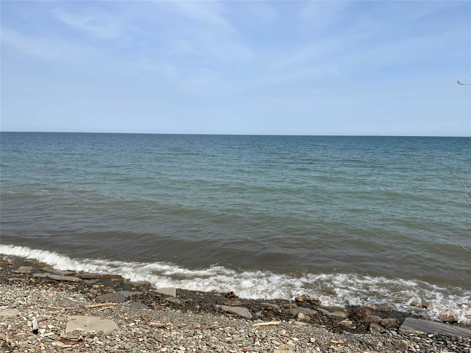 Build Your Dream Home Or Winery On This Lake Ontario Waterfront Lot! This 20 Acre Lot Features A Rolling Landscaped Downwards To Lake Ontario With Approx 143 Feet Of Water Frontage On Lake Ontario. Views Of The Toronto Skyline As Well As Niagara Escarpment! The Severed Lot Will Have 2 Entrances To The Property. Excess Acreage Are Cleared Fertile Lands Ready For The New Plantings Or Wedding Venue! Seller Will Sever Property At Their Own Expense.