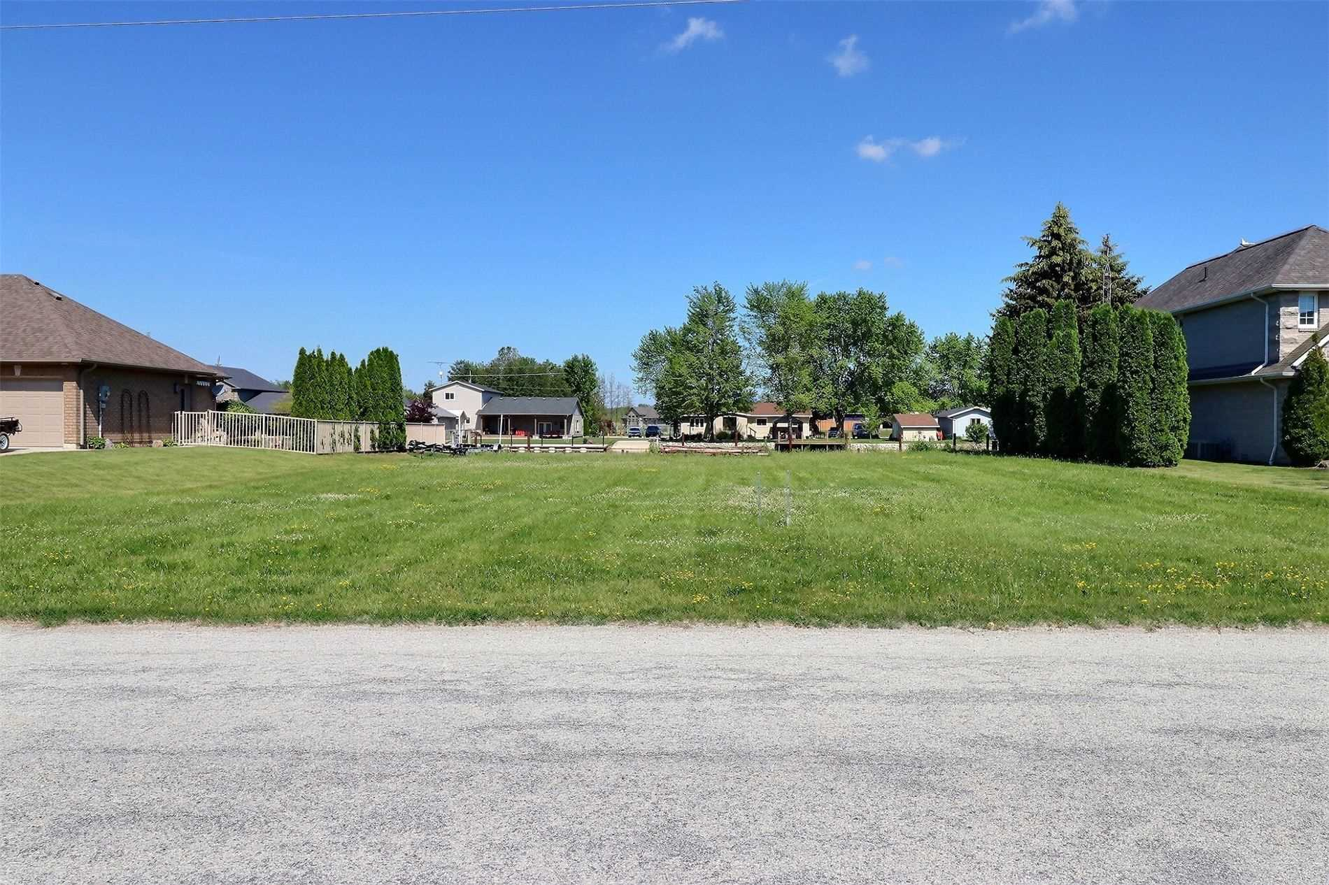 When Viewing This Property On Realtor.Ca Please Click On The 'Multimedia' Link Below For More Property Info. Located On One Of The Widest Channels In Lighthouse Cove (A Golf Cart Community), This Vacant Waterfront Property Features Great Fishing And Easy Access To Highway 401. Lot Size Is 100' F X 150' D.  Water And Hydro At Road; Septic System Is Required. Piles Installed - Ready To Build A Dock. A Beautiful Location To Build Your Dream Home!