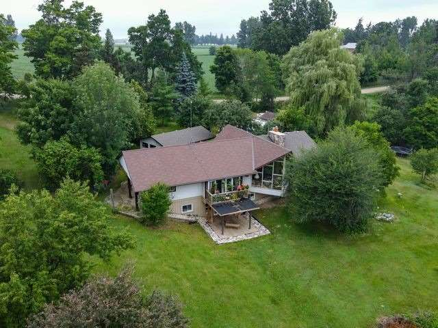 Your Very Own Lake! No Need For A Cottage Or Weekend Getaway. Located Less Than 10 Mins To Elora On 53 Acres. 12 Acres Of Workable Land. Perfect For A Hobby Farmer. A-Frame Style Bungalow Overlooks The Rolling Hills And Secondary Pond. Soaring Cathedral Ceilings With Floor To Ceiling Windows. 3 Bathrooms And 3 Bedrooms On Main Level, Two Bdrms In Basement.  Potential In-Law Suite Capabilities. Must See To Appreciate.