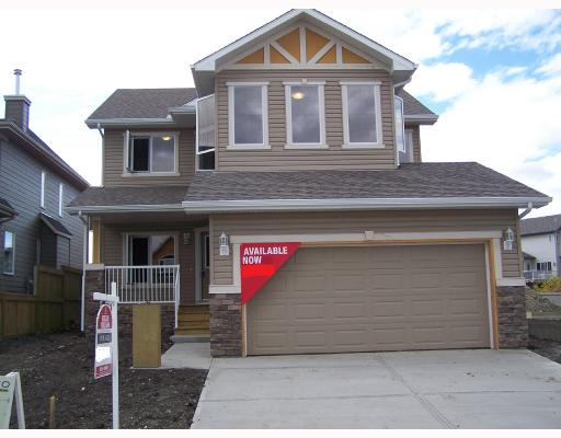 Thinging of moving to Okotoks? The value is certainly in this quaint town. Imagine getting a beautifully upgraded Coco Homes home for this price. This home is loaded. As you enter you will notice the wonderful large front porch, perfect for a morning coffee. The main floor den has pocket doors for privacy.This home features an abundance of upgrades, including hardwood flooring, granite counters in the huge kitchen, 4 kitchen appliances and a front load washer and dryer. You will also notice that Coco Homes has matched the pantry door to the cabinets, no out of place white door here. Another feature is the maple railing with cast spindles. Looking for 3 bedrooms with a bonus room? This home has that too! You must view this home to appreciate it. Coco Homes goes above and beyond to ensure that your move up home is special. They have even included a high efficiency furnace to keep your heating bills down. Take a short drive to Cimarron Drive in Okotoks and see what this builder has to offer.