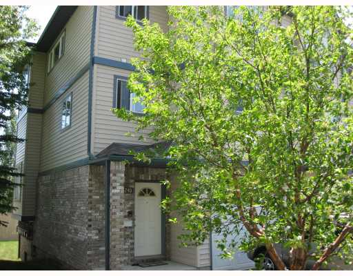 The largest unit in the complex, private back yard, city views and partial mountain views in this end unit. Visitor parking just steps from the front door.   Enjoy the bright and spacious floor plan with an abundance of windows everywhere.  The large living room offers a cozy corner gas fireplace with new hardwood floors, and grand 15 ft. ceilings.  Enjoy the large master bedroom with his/her closets and a nice sized en suite.  The 2nd bedroom also has its own 3 piece en suite.  Finally, enjoy the walkout basement level on to your own private backyard.