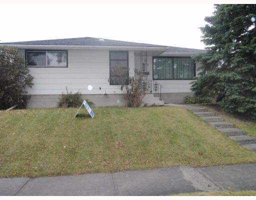 """Location location!! VARSITY ACRES! This home is located strategically on Varsity Drive, across from Varsity community center and Varsity Acres School, and close to ALL amenties! Market mall and Northland Mall are just a hop-skip-and-a-jump away! Close to AB Childrens Hospital and the U of C. Very well laid out bungalow with hard wood and tile flooring on the main level and carpet in the fully finished basement. With a large living room on the main, dining, kitchen, 3 bedrooms and one and a half baths, there is lots and lots of living space. The fully finished basement consists of 2 bedrooms, a room that can be used as a den or storage, a huge family room with a dry bar and a full bathroom. The furnace, humidifier and hotwater tank are only a few years old. The back yard is huge, with a concrete patio, a RV pad, a fire pit and a huge 23.5'X 21.5"""" insulated garage. And still, lots of space left in the back yard. With your touch, this can be THE HOME!"""