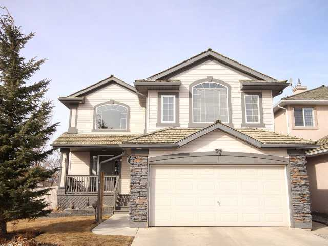 Start your day off with your morning coffee on the VERANDA, then walk or take to the BIKE TRAILS to enjoy breath taking VIEWS of the city, Bow River & Fish Creek only a block away! This sunny home offers the IDEAL floor plan for a busy family, with a total of 4 bedrooms and 2.5 baths on 3 fully finished levels. UPGRADED flooring throughout, with elegant HARDWOOD on the main and new carpet up. The FUNCTIONAL main level features LARGE ROOMS, including an office with French doors, family room with one of TWO GAS FIREPLACES and an eat-in kitchen. The soaring foyer, accented by a dramatic CURVED STAIRCASE, leads you up to your BONUS ROOM, with VAULTED ceilings and 2nd fireplace. Down the hall, you'll find the master suite (walk-in closet, 4-pce ENSUITE), and the 2 secondary bedrooms. The PROFESSIONALLY-DEVELOPED lower level offers the 4th bedroom, with MASSIVE rec room and windows so big, you'll feel like you are on the main level! CENTRAL AIR, RV parking and a true MOUNTAIN VIEW complete the package.
