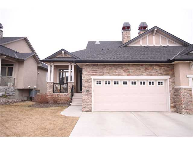 Your well deserved LIFESTYLE awaits! This sophisticated home offers quiet COMFORT just steps from nature's FISH CREEK park. The DRAWING POWER of this polished, WALKOUT bungalow include an ultra high VAULTED ceiling, beautiful birch hardwood flooring, a formal yet INTIMATE dining area, STYLISH kitchen with granite counter tops and stainless steel appliances. The living room area delivers a picturesque VIEW of the park, a cozy, signature fireplace and pure comfort. The master bedroom has it's own 4 piece ensuite with a DELICIOUSLY deep soaker tub and separate shower. The lower walkout level is made up of an EXPANSIVE, carpeted family area with a second fireplace, two guest bedrooms and a 4 piece bath. This home is PERFECTLY placed, backing onto a green space and walk path. The grounds are professionally tended to, with lawn care and snow removal. There is no need to trouble yourself here....your new lifestyle AWAITS.