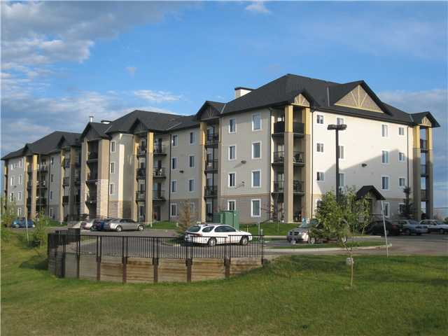 Welcome home!!  This condo is located in the heart of Airdrie close to restaurants and shopping.  As you drive into the development you will be impressed with the pride taken in maintaining the grounds and common areas.  Inside this suite you will find a very well maintained and tastefully decorated one bedroom plus den.  All of the appliances are included with this purchase and your condo fees even include electricity.  This suite is located on the East side of the building with a view of the pond.  It is on the mainfloor, so it has the convenience of a large walk up patio.  Come and view this great home today.
