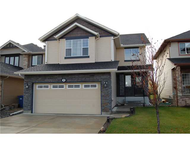 Location, Location! This property has a south facing, very private yard, backing onto miles of green space, a pond, and walking paths. This is a gorgeous, fully developed, 4 bedroom home, featuring over 2300 sq ft of living space! The main floor welcomes you with an open concept kitchen & living room, cozy fireplace, an office/den, laundry, and a large eating area. Upstairs you will find a huge bonus room with vaulted ceiling, large windows & built in wall unit. There are also 3 good-sized bedrooms, including the master suite, complete with huge ensuite and walk-in closet. Downstairs has been professionally developed with a large rec room, full bathroom & the 4th bedroom. The yard is fully landscaped, fenced & even has underground sprinklers. Located in one of Calgary's best planned communities, with tons of pathways, green spaces, many amenities, and easy access to major routes, make sure you add this one to your list to see!