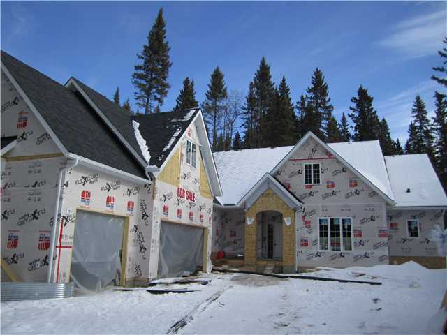 WOW - Unbelievable value in Hawk's Landing - Priddis - only 15 minutes from Calgary!  BRAND NEW custom built executive bungalow on a HUGE, 1.5 acre, heavily treed lot in very quiet cul-de-sac.  Home will be completed in early June, is just getting the finishing touches and the builder is willing to let you make some of the final cosmetic decisions.  This fantastic home will include: 2 bedrooms above grade, 3 full bathrooms, triple oversized insulated & drywalled garage, beautiful kitchen with granite counters and a walk through pantry, large front entry, living room, laundry room, dining room, large master en suite bathroom and huge walk in closet, massive rear covered porch (60'x14') and much more.  Price even includes GST - WOW!  Builder can complete basement for additional cost.