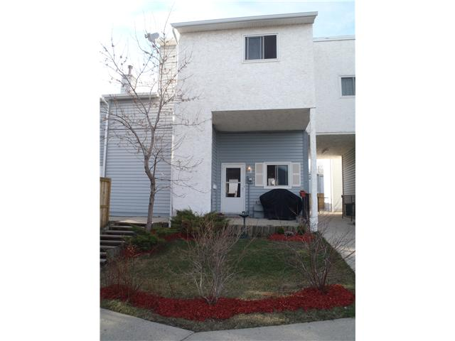 Come check out this lovely unit in Falconridge Manor.  It features a kitchen, dining area & large living room on the main level with patio doors leading into a fenced backyard.  This is one of the few units that also has a front yard!!!  The upper floor features a unique layout with 3 good size bedrooms & a 4 piece bathroom.  The basement is developed & all that is left to complete it is the ceiling - it has a large recreation room/office & a laundry/furnace/storage room.  There has been many RECENT RENOVATIONS which include SIDING, FENCES, NEW WINDOWS, PATIO DOOR, LAMINATE FLOORING in living room & dining area & the BATHTUB & SURROUND were done by bath fitters.  Seller is offering a CREDIT for NEW CARPET - please call to discuss.  This is a great location being very close to schools, parks, shopping & public transportation.  This is one of the largest units in this complex & it comes with one assigned parking stall which is No. 51.  Perfect starter home or investment property.