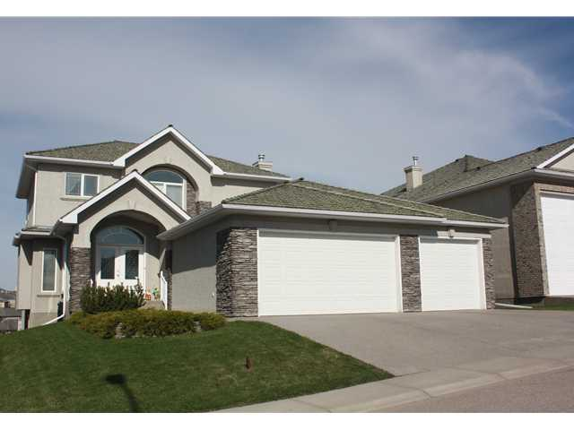 Let your new home dreams come true! This 2400 plus sq.ft walkout, 2 storey home is waiting for you.  Backing onto the RAVINE and panoramic MOUNTAIN VIEWS are just two of the exciting features of this home.  The main floor is complete with a flex room perfect for a formal dining room or den.  There are large windows surrounding the gas fireplace and a chef's dream for a kitchen.  There are granite counter tops, an Ultraline 6 burner stove, dual built in ovens, a new Miele dishwasher and a massive walk through pantry. Upstairs you have 3 bedrooms and a loft.  The master retreat is spacious with a 5pc ensuite incl. granite counter tops, a corner jetted tub and a seperate shower.  The walkout basement has a wet bar, a 4th bedroom and a security room with a steel door and frame.  The triple garage is unbelievable.  With heated flooring, built in cabinets and shelves, 220v, drainage,hot & cold sink;a total of 1030sq.ft.  This has so much more but I am out of space.  Call today and book your viewing.