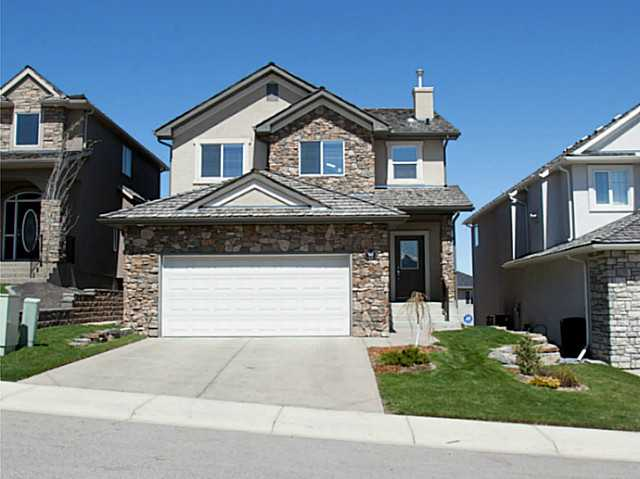 Amazing 2 storey home with Seven bedrooms and fully finished walk-out basement. You will feel at at home from the minute you see it , stucco exterior with stone trim and exceptional landscaping. Welcome home to a large foyer with bench seating and large windows for natural lighting. Dining room is home to grand piano and open to above with most of the main floor hardwood  provides a level of elegance. Kitchen is open concept with extra storage and corner pantry, stainless steel appliances and granite counters. Great is open with large windows , fireplace and plenty of room. Four bedrooms on the upper level with 5pc bathroom and full spa - inspired ensuite with walk in closet for the master. Lower level has 3 bedrooms , 4pc bathroom and great room with fireplace and door to the patio our back. Home is in very good shape with upgrades everywhere , perfect for a large family. Custom built home with all the right features.