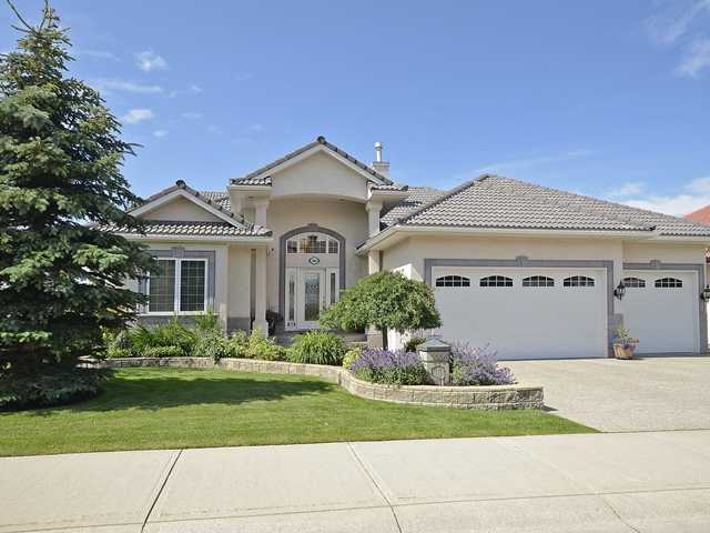 OPEN HOUSE SUN JULY 22, 1:30-4:00 BEAUTIFUL WALKOUT RIDGE BUNGALOW with AMAZING PANORAMIC MOUNTAIN VIEWS(all 3 levels).  So many upgrades including a GOURMET KITCHEN with double ovens, large island, rich oak cupboards and granite counter tops. Other features include high ceilings, modern paint colors -  newer appliances, furnace and hot water tanks. Large great room with soaring 2 st ceilings,a wall of built-ins, stone facing gas fireplace, floor to ceiling windows with FULL MOUNTAIN VIEWS. Large master bedroom has a 5 piece ensuite and walk in closet.  Main floor has a second guest bdrm(office) with ensuite. STUNNING MAIN FOYER, curved stairs to walkout level and open stairs to upper loft/den area. Formal dining room perfect for large parties.  SPECTACULAR walk out level has in floor heating, massive family room,  bar area, games room, 2 large bdrms and 4 piece bath. TRIPLE CAR GARAGE is every man's dream with spotless heated floors and a sink. MASSIVE PRIVATE LOT with city green space on east lot.