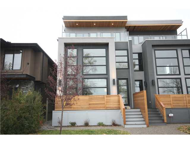 Beautiful Brand New 3 storey infill across Glenmore Park. Unique design & layout offering 4 floors completely finished with 4,146 square feet of living space.  Main Floor has 2 living rooms, kitchen with a huge island, dining area, powder room, & a Cafe spot. 2nd floor has 2 bedrooms with walk-in closets, 5 pc bath, laundry room (with sink), & a flex room. 3rd floor has the master bedroom, ensuite with heated floor, skylight, dual sinks, air jet tub, & a huge shower (steam, jets, rain head, & handheld).  This floor also has 2 living rooms (1 in master & another over-looking the park) & a study area.  Basement has a 4th bedroom, full bath, wet bar, & a massive living room with coffered ceilings (infloor heating RI). All high-end products & quality finishings. Glass railings, 9 ft ceilings, Quartz counters, RI for outdoor fireplace & air conditioning... Price includes over $55,000 GST.  Built by Prominent Homes (Master Builder). Click on the Virtual Tour & Brochure link for lots more pics & panoramic views.