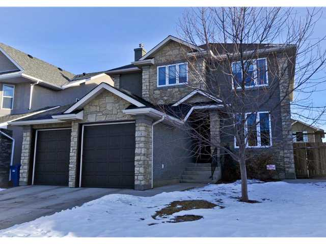 Rare find in Strathlea! Once in a while there comes a listing in sought after Strathlea. Here is a terrific opportunity to be located in a great location. With neutral colors, rich maple floors and a superb open concept, you are left wanting more. A well laid out professionally developed kitchen, featuring top end appliances including a gas range and stove, is highlighted by the unique extraction system. But wait there is more, like a two way indoor/outdoor gas fireplace that frames the yard, central air and enormous wrap around deck. Once up the ultra modern open stairs you are greeted by a loft/play room as well as 3 generous bedrooms. Swing back down by the cork floored office and laundry/mud room and you find yourself in a professionally developed basement that includes a private wine cellar, exercise room/conservatory and 4th bedroom. Oversized lower windows help bring ample light in all day long. Finish off in a media room with corner fireplace. There is plenty of storage in this unique, practical