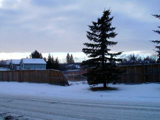 Great building lot in mature area of Cochrane.Large trees in area and conveniently located close to schools and shops. This lot is large enough to build 6 units and is ready for development. GST may be applicable.Lot is listed under Town of Cochrane assessment