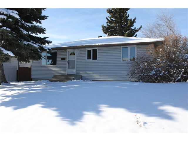 Great Investment Opportunity!   Nicely updated suited bungalow on a 50' by 125' R-2 zoned lot. Fresh paint throughout! New shingles, furnace, fence and garage door. Also, recently updated windows, laminate flooring and doors. 22' x 24' garage with new door, as well as a 24' x 36' parking area. 3 bedrooms up and one bedroom M.I.L. suite down with separate shared laundry room, great for co-habitation. Sunny west facing backyard with mature trees. Close to schools, shopping and just minutes to downtown. Great opportunity for a cash flow property! Call for your viewing today!