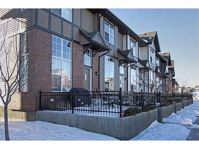 This immaculate END unit 3 bedroom townhome is ready to move into. It features a charming fenced courtyard and is located on a quiet cul-de-sac road with ample street and visitor parking in addition to a DOUBLE attached GARAGE.  Upon arrival, you'll first notice the soaring ceilings and windows in the living room, providing plenty of natural light and an airy feel.  The main floor is gleaming hardwood and also features a spacious dining room and generous kitchen with a raised eating bar and plenty of storage in your expresso MAPLE cabinets.  Upstairs you'll find three good sized bedrooms, making this home ideal for professionals requiring an office area or for family life. New Brighton offers great community center activities and is close to a major shopping hub and the new hospital. Shows like new.
