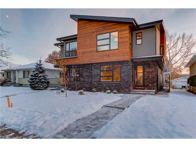 Absolutely Gorgeous Custom Luxury Home Located in the heart of most popular Banff Trail!!! Minutes to Downtown and all amenities. This home boasts Modern Contemporary Design, Acrylic Stucco, Stone & Cedar Exterior, Premium Granite Counters tops, Mosaic, Glass & Porcelain Tiles, Custom HPL Cabinets with Soft Closing Doors & Drawers, 9 Ft Ceiling Height on all floors, 8 Ft Custom Doors,Stainmaster Carpet, Glass/Maple Railing, Master w/Vaulted Ceilings & 5-pc Ensuite Tub w/heated backrest,Party Wall is 2X6 on each side.Exposed Aggregate Sidewalks & Patio. Double Detached Garage!!! This is the one for you!!!