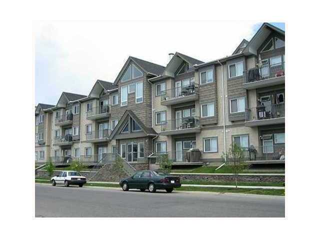 """Come see the stunning 270 degree panoramic VIEW from this corner 'TOP FLOOR' unit in the Stonecroft at Cedarbrae!  Built in 2005, this modern condo boasts DECADENCE and LUXURY.  9"""" ceilings, crown molding, earthtone colour scheme, GRANITE countertops,  STAINLESS STEEL appliances, engineered SOUNDPROOFING and HEATED FLOORS throughout!  Storage, storage & STORAGE: Heated underground parking, heated bicycle storage room, storage locker in front of parking stall, in-suite storage room and convenient in-suite laundry.  WALK-IN CLOSET and 3 piece ensuite in master and 2nd bedroom located directly next to 4 piece bathroom.  Large INSET WINDOWS in bedrooms and an OVERSIZED WRAPPING BALCONY with bbq gas hookup for those days you need to cook outside and a cozy gas fireplace to curl up to at night.  Make this home your MAINTENANCE FREE lifestyle.  GYM and party room options are also available in building. Welcome home!"""