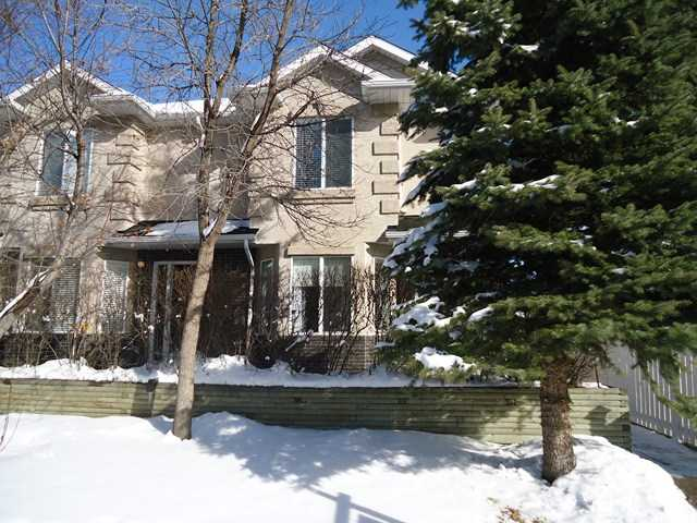 Owner-occupied ,this unit shows the pride of ownership. This Beautiful 2 bedroom townhouse unit is close to schools, parks, shopping and just minutes to downtown. Features embrace a covered entry way, hardwood floors on most of the main level, knock down ceilings, skylight, living room with 2 sided gas fireplace, dining area and kitchen with tile floors, track lighting, pantry, eating area and white cabinets and appliances. There are 2 bedrooms and 4 piece main bath with jetted tub up. Both bedrooms include a walk-in closet. The developed basement has a media room with surround sound, a 3 piece bath, laundry and storage. Single car garage parking off the paved back lane.