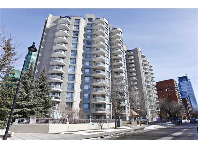 "Very well maintained 1 bedroom plus den unit in the ""Liberte"" in prestigious Eau Claire. Open plan has lots of glass and offers plenty of natural light. Large kitchen with high gloss lacquer cabinets and eating bar. Impressive and spacious living areas have marble faced fireplace and open to a large balcony. Comfortable den with glass wall and double door access. Good sized master bedroom has 4 piece ensuite including soaker tub. The second bathroom is the main 3 piece with corner shower. Insuite laundry. Amenities and features include newly renovated common areas, underground visitor parking, tennis court, exercise room, party room, secured entry, bike room storage. The Bow River pathways, Prince's Island park and downtown Calgary are so close."