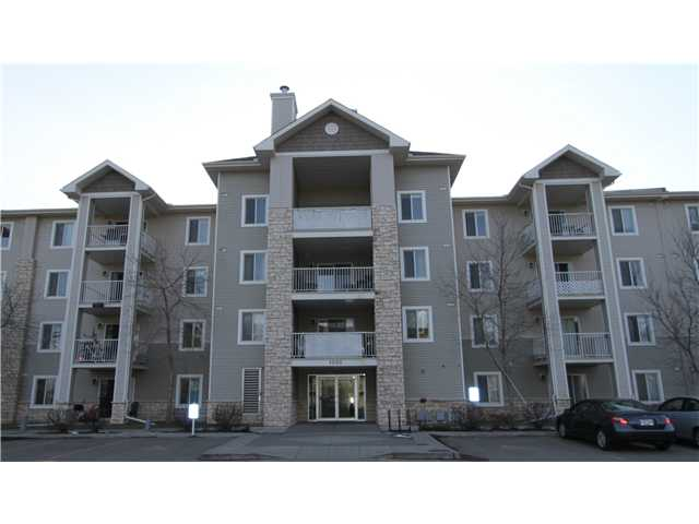Great Location! This sunny TOP FLOOR, West facing condo features 2 spacious bedrooms, 2 bathrooms, a bright open kitchen area, and good sized great room. Enjoy the convenience of in-suite laundry facility and storage area.  Take in the beautiful MOUNTAIN VIEWS from the entertainment sized balcony. Heated, underground parking. Located close to schools, parks, playgrounds and biking paths and Fish Creek!