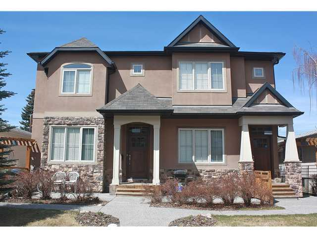 OPEN HOUSE SATJune 1, 2-4p.  This 4 plex is located near the Foothills and Alberta Children's Hospitals. The Bow River Pathway is just 2 blocks away and you can be out of the city on your way to the mountains with ease. This unit boasts class and elegance. From hardwood flooring to granite on all counter tops this home is sure to please. The carpet has been recently replaced. The main floor has an open concept great for entertaining. The kitchen has stainless steel appliances and loads of maple wood finished cabinets. The great room has a gorgeous gas fireplace with mantle and tile surround. Upstairs you have two bedrooms. Both with walk in closets and ensuites. One with a 4pc and one a 3pc. The laundry is also located on the upper level. The lower level is fully finished with a built in wall unit, a roughed in bathroom and plenty of storage. Outside, you have a very private patio area with a gas outlet for the bbq. Last but not least, a detached single garage. Call today and avoid disappointment!