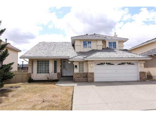 "* Please click on ""VIEW MULTIMEDIA"" to view virtual tour * This 2 storey split has been VERY well maintained by the ORIGINAL owners & shows 10 out of 10! Location is excellent - 10 minute walk to the Crowfoot LRT station, 15 minute drive to downtown, 2 blocks from Crowfoot Arenas/Scenic Acres Park, plus all the shopping you can handle at Crowfoot Crossing! Features of this amazing home include: fully developed walkout basement, towering vaulted ceilings, wood burning fireplace with log lighter, covered deck with stairs down to the private sunny SOUTH facing back yard, 5 bedrooms (6 with the den as a bedroom), dramatic curved staircase, hardwood floors, good sized master bedroom with 4-piece en suite bath & private balcony, covered patio, large spacious kitchen, insulated & fully finished double oversized garage, big laundry room with cabinets, 2 furnaces & much more! Move in and enjoy or renovate - either way this is a very solid, well built home just waiting for new owners to call it home!"