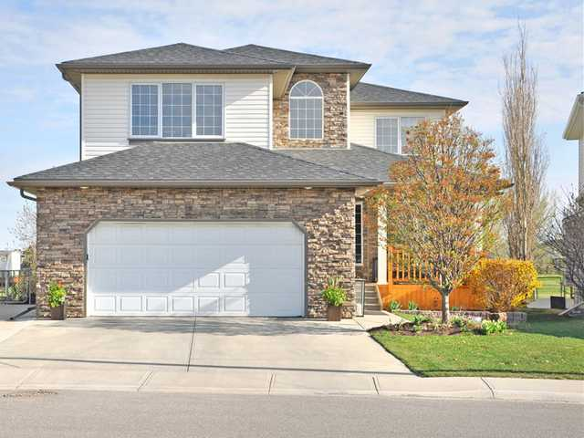 Looking for a large upgraded home with fabulous views close to both public & separate schools? Located on a cul-de-sac on the 2nd hole of the Woodside Golf Course you will appreciate the renovated exterior, including extensive stone detailing, new in 2010 roof, soffits & eavestrough & one of the prettiest front doors around. As you enter the views start right at the foyer. The open plan allows the view to pour in in every direction. The main floor den is conveniently located off of the front entrance. The 3 sided stone fireplace is perfectly placed to add ambiance to the large living & dining area. Wait until you see this sprawling kitchen. Upgraded with granite & high end appliances, including a Miele dishwasher, this kitchen would make any chef proud. Upstairs enjoy your large bonus room with more fabulous views & a wonderful master retreat with large ensuite. A fully developed basement houses the 4th & 5th bedroom, 4 pc bath & huge lifestyles room. Click on the photos for more details.