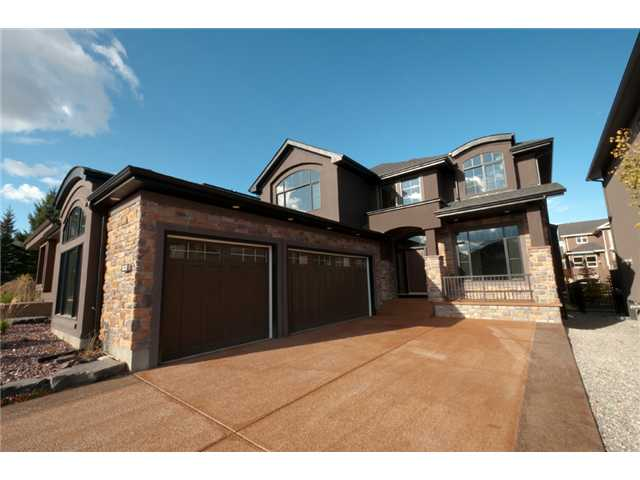 """This custom built home sits at the end of a quiet cul-de-sac, has an amazing chef's kitchen and unique turreted corner, and is offered at a price your accountant will approve of.  The beautiful kitchen was designed by successful restauranteurs, and includes a huge Viking Pro Series fridge and 6 burner gas stove, Meile Inspira dishwasher, wall oven and steamer.  The granite is solid 1 1/4"""" throughout the house, and the built-in cabinets all around help keep things tidy.  Upstairs the huge master closet has a large skylight offering a natural look at what you will wear, and the ensuite includes a steam shower, heated tiles, and his and her sinks.  The fully finished walkout is well laid out, offers bedrooms 4 and 5, a big open rec area, media room, and walks out to a secluded private patio under the main deck.  The home feels great and is priced to move you."""