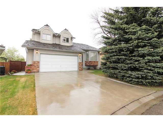 "* Please click on ""VIEW MULTIMEDIA"" to view virtual tour * Located on an incredibly quiet street with a huge pie lot - this 2 storey walkout has been exceptionally well maintained by its ORIGINAL owners! Features include: professionally crafted solid wood built-in cabinetry & work spaces, towering vaulted ceilings, large open dining space for large family gatherings, fully finished WALKOUT basement with 9ft ceilings, HUGE private back yard retreat, gas fireplace (that could be converted back to wood), central air conditioning, deck with mountain views, 5 bedrooms including generous master with 4-piece en suite, newer furnace (2011) and much more! Location is 10/10 - 8 minute walk to the Crowfoot LRT station, 15 minute drive to downtown, 5 blocks to Crowfoot Arenas, 2 blocks to Scenic Acres Park, plus all the shopping you can handle at Crowfoot Crossing just over Crowchild Trail! This home boasts total pride in ownership and is a must see."
