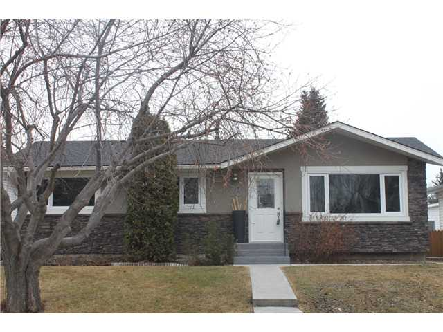 "LOCATION, LOCATION, LOCATION!!!! This completely redone 4 bedroom 2 bathroom bungalow has it all starting with new stucco and stone front faced,new soffit/fascia/trough,newer roof,new frontstep and new front door. The inside is you guessed it new with hand-scraped hardwood floors sprawling the open concept livingroom,diningroom and kitchen area.Kitchen is a chef's dream with all new expresso stained cabinets, 1 1/4"" granite,stainless appliances including a 5-burner gas stove.3 bedrooms up are good sized with all new finishings and the main bathroom/ensuite boasts custom double vanities, designer tile, heated floors and new fixtures.Lower level is fully developed with rec room, bedroom,office and another 4-piece heated floor bathroom.Large laundry storage area completes this cozy basement get away.New triple pain low E windows, new hot water tank,new attic insulation,new composite rear deck, storage shed and an oversized 24x26 garage complete this amazing property."