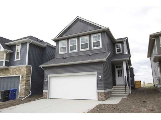 Amazing Atwood Model by Broadview Homes!!! This great plan boasts 3 bedrooms and 2.5 bathrooms across from an open park/green space and up the road from a future grocery store and many amenities. The main floor sprawls with maple hardwood floors, a spacious kitchen complete with stainless appliances, granite countertops and a walk through pantry. The great room features a modern elongated fireplace and large windows overlooking your beautiful backyard. Maple railings lead you to the upper floor where you will find 3 bedrooms a central bonusroom area complete with tray ceiling and a master suite with 5-peice ensuite including oversized shower and a great walk-in closet. Bathrooms include tile and granite counter tops and the home comes with a full warranty from one of Calgary's most reputable builders. Call today for your private viewing!!