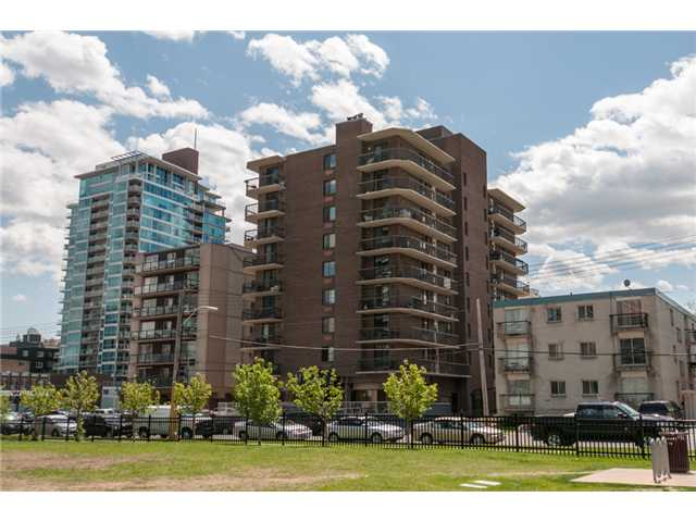 FANTASTIC LOCATION WITH GREAT VIEWS AND TITLED PARKING!!!! Situated across from a park, tennis courts, recreation center, short walk to the C-train, Stampede Grounds, The Red Mile, and lots of other amenities. This 2 bedroom condo is over 1200 sq ft, open floor plan, COMPLETELY RENOVATED. Everything NEW: Kitchen cabinets, top grade GRANITE counter top, Stainless steel appliances, ceramic tile floor, new carpet in the bedrooms, CROWN MOLDINGS throughout, Knockdown ceiling, gorgeous fireplace with slate tile, baseboards, doors, main bath with slate tile, huge master bedroom with 2 large closets and a beautiful ensuite bathroom with extra large shower, 2 patio doors to a wrap around balcony, SLATE tile floor and GORGEOUS VIEWS from this SE corner unit, in suite laundry room and storage and the list goes on. Concrete building with substantial upgrades and more in the works. YOU CAN HAVE IT ALL!!!