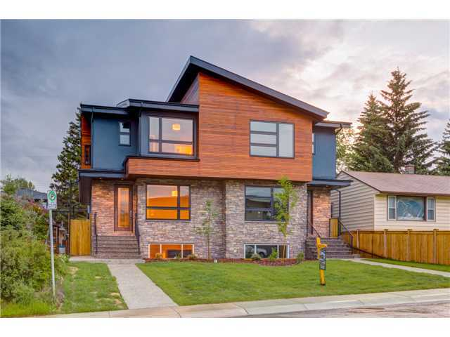 OPEN HOUSE THURSDAY AUGUST 15,2013 (4PM-7PM). Absolutely Gorgeous Custom Luxury Home Located in the heart of most popular Parkdale!!!Minutes to Downtown and all amenities. This home boasts Modern Contemporary Design, Acrylic Stucco, Stone & Cedar Exterior,Premumium Granite Countertops, Mosaic Glass & Porcelain Tiles,Custom HPL Cabinets with Soft Closing Doors & Drawers,9ft Ceiling Height on all Three floors, 8ft Custom Doors, Stain Master Carpet, Glass/Maple Railing, Master w/Vaulted Ceilings & 5-pc Ensuite Tub w/heated backrest, Party Wall is 2x6 on each side. Exposed Aggregate Sidewalks & Patio.Double Detached Garage!!! This is the one for you!!!