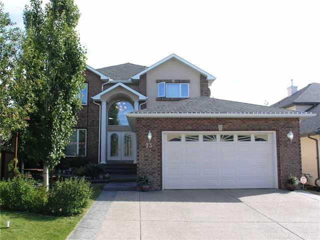 "* Please click on ""VIEW MULTIMEDIA"" to view virtual tour * Welcome to a beautiful home tucked away in the estate area of Signature Park called ""Simcoe Heights"". This fabulous fully finished 2 storey is loaded with features including: open gourmet kitchen with granite counters, towering main floor vaulted ceilings, huge master retreat with en suite ""oasis"", 6 good sized bedrooms (4+2), fully finished basement with amazing wet bar & movie area, oversized/insulated double garage, large formal dining room, rare brick exterior, crown moldings & high quality built-ins throughout, main floor den, 2 tiered deck made with high quality ""Dura-Deck"", underground sprinklers and much more. Location of this home is absolutely perfect - Westside Rec Center, Ernest Manning High School, NEW LRT station, Ambrose University College & Rundle College - ALL within 5 blocks! Also very close to Webber Academy, all the shopping at Aspen Landing and only a 15 minute drive to downtown."