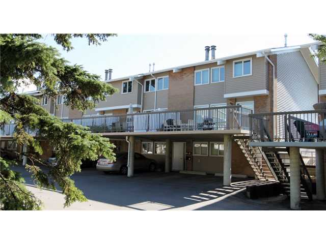 FANTASTIC LOCATION! AMAZING VALUE! Situated in the highly desirable community of Silver Springs, close to the U of C, and mere steps from bike paths and the beautiful Bowmont Park Natural Reserve, this three bedroom townhouse is the perfect opportunity for the home buyer or investor.  This well maintained unit features beautiful laminate flooring, a bright open living room, dining room, and efficient kitchen with tile backsplash. Enjoy the cozy double-sided fireplace in the colder months. Upstairs you'll find two spacious bedrooms and a full bathroom. There's plenty of room for storage in the lower level laundry room along with a half bathroom and THIRD bedroom. The entertainment sized patio is perfect for summer barbecues with family and friends. Don't miss this opportunity! Call Now To View!