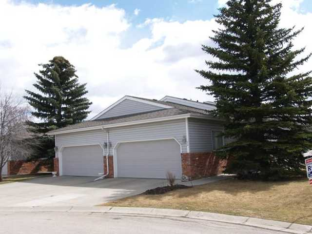 "Great Value! Walkout Bungalow with oversize Double attached garage in a attached Bungalow complex built by Statesman next to the Bow River. No condo fees, no age restriction, no flood issues here. The home offers Vaulted ceilings, an open floor plan, neutral decor, ""wood burning"" fireplace. It also features a semi formal living and dining room, a master with full ensuite and second bedroom or could be an office, plus a great kitchen with oak cabinets and sunshine ceiling, a nook leading to an east facing deck.  Lower level features 2 bedrooms plus flex rooms for office or hobby area, a full 4 piece bath in the walkout basement. Lots of storage area. All yard maintenance and snow removal done by the home owners association ($145.00 a month. Ideal for someone working in close proximity to the UofC, Foothills or Childrens Hospital and just a 5 minutes drive away. 15 minutes to downtown. 2-4 minute walk to shopping, Shouldice Pool, Transit and river walkways.Original Owner, very well kept!"