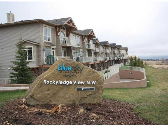 OPEN HOUSE Sat. Nov 9,  2-4p.  This Blue Sky unit is great for the first time buyer or revenue property.. This unit boasts incredible mountain views.  Whether its from your living room or the master bedroom, you won't be disappointed. This two bedroom unit has upstairs laundry, a master with a 3pc ensuite and an additional 4pc bath upstairs.  The main level has a 1/2 bath, tile flooring leading you to a galley kitchen with eating bar, loads of counter space, maple cabinets in a rich stain and stainless steel appliances. The living room is spacious and leads to your no maintenance deck with incredible mountain views. There is also a gas line for the bbq. There is a single indoor titled parking stall with a storage locker nearby. And if you like to exercise, a large gym with an abundance of equipment. Close by, you have the Rocky Ridge shopping area with a Coop grocery and gas station, bank, dentist, and more.  And with the new Tuscany Station LRT opening in 2014, this location is hard to beat.
