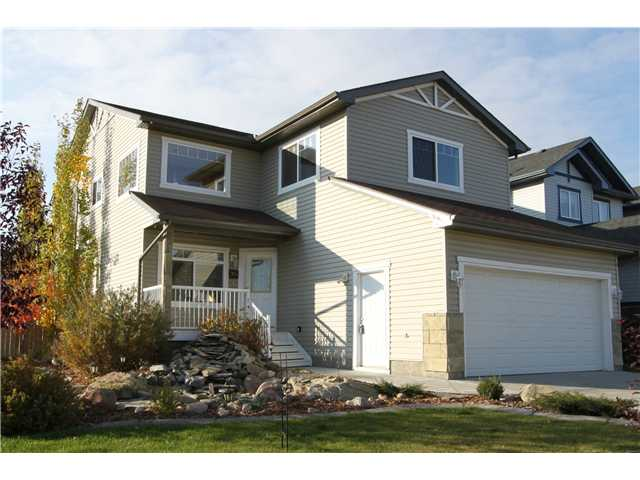 LOOKING FOR EXTRA SPACE? This 2-storey Airdrie home was built for the growing family. 4 upper plus 2 lower spacious bedrooms and one office/den in the basement that could easily be converted into a 7th bedroom. The stunning kitchen was designed for the domestic Iron Chef featuring a stainless steel countertop on the eating bar, dual built-in ovens, a 6-element gas cooktop with a deep food warmer drawer, and plenty of storage space. The master bedroom ensuite showcases a 4 ft. shower and jetted soaker tub. Slate with hardwood nosing steps lead you to the fully finished basement. The bedrooms each have electric baseboard heating for extra temperature control. Not to forget the two-tiered decks that are perfect for entertainment and the RV parking pad in the backyard. This home is rich with built-in cabinetry throughout and much more. Available for an immediate possession. Call now to view!
