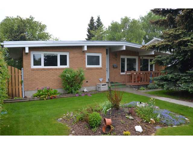 The neighbourhood speaks for its self but the house shouts out...style, character & charm! This solid bungalow offers peace of mind & comfort.  Enjoy the open concept living room & kitchen featuring a large island, granite counter tops, cupboards w/ pull out shelves including soft close cabinet doors.  Complete appliance package, under mount sink, large bright windows & a cozy fireplace.  After a long day, you can escape to the spas like bathroom & relax in the shower that has 10 separate shower heads.  The 3 bedrooms upstairs offer closet organizers & hard wood floors.  A newly renovated (illegal) suite boasts 2 bedrooms, den, great size kitchen, living room & large windows.  A large private back yard is just another huge benefit to this fantastic home.  It has hosted a sit down wedding for 100 people w/ 50 seated on the garage top deck & 50 on the lawn.  The flower beds are loaded with perennials, under ground sprinklers, large garden shed & a double detached garage make this backyard complete.