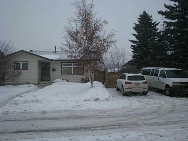 Fantastic opportunity for back yard mechanic or first time buyer. This quaint 3 bedroom 2.5 bath home on a quiet street in Falconridge has recent renovations including shingles,vinyl windows,high efficientcy furnace,fencing,appliances and more!The upstairs features a large living room siding onto a spacious kitchen with eating area, with newer appliances and flooring.3 bedrooms on the main with a master bedroom including a 2 piece en suite. The basement is perfect for entertaining with a rec room and fantastic games/mans room with bar.The lower level also includes a den ,4pce bath and laundry room, front load washer & dryer included!This home is beautifully fenced and includes RV/boat parking,3 off street stalls and a 24x24 garage! Close to Schools transit and shopping and easy access to the ring road! The expensive items have been completed. Why wait? This is the home you have been waiting for!
