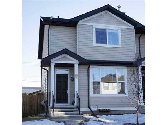 Steps away from Superstore.  Welcome to this cozy half duplex in convenient Coventry Hills.  It features 2 large bedrooms, both with 4 pieces ensuite, main floor with 9 feet ceiling, hardwood flooring, large living room with corner fireplace, open kitchen, oversize double garage, and large deck.  It closes to shopping, public transit, playground, and school.  ** 35 Covehaven Mews NE **