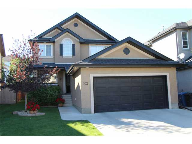 INCREDIBLE FULLY FINISHED ESTATE 2 STOREY WITH FANTASTIC QUITE LOCATION ACROSS FROM ENTRANCE TO GREEN SPACE RAVINE & PATHWAY! THIS HOME FEATURES GREAT WEST BACKING PIE LOT 1 BLOCK TO 2 SCHOOLS & A TOTAL OF 4 BEDROOMS & 4 BATHROOMS! HIGH QUALITY UPGRADES THROUGHOUT INCLUDING; HARDWOOD FLOORS THROUGH MAIN, AIR CONDITIONING!, MAPLE RAILINGS, HEATED CERAMIC TILE IN BATHROOM!, WIRED FOR SOUND IN FAMILY ROOM & REC.ROOM, & UNDERGROUND SPRINKLERS! BEAUTIFUL OPEN KITCHEN WITH MAPLE CABINETS, BREAKFAST BAR, AND GIANT EATING NOOK! WALK THROUGH PANTRY! MAIN FLOOR FAMILY ROOM WITH GAS FIREPLACE AND CUSTOM MEDIA BUILT INS! BRIGHT MAIN FLOOR DEN/FLEX ROOM WITH BEAUTIFUL ARCHES THROUGHOUT! TOTAL OF 3 HUGE BEDROOMS UP & 4TH BEDROOM IN FINISHED LOWER LEVEL, BEAUTIFUL ENSUITE OFF LARGE MASTER SUITE! PROFESSIONALLY FINISHED LOWER LEVEL WITH REC.ROOM, GAMES ROOM, BEDROOM, & FULL BATH!FANTASTIC OVERSIZED DOUBLE ATTACHED GARAGE! LANDSCAPED & FENCED WITH FULL WIDTH OVERSIZED DECK ON WEST BACKING YARD! SIMPLY A BEAUTIFUL HOME!