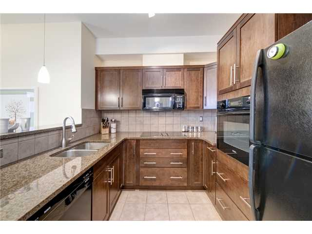 Looking for 2 titled parking stalls? In a tastefully upgraded, south-facing unit overlooking the courtyard?  Want a pet-friendly complex and need a flexible move-in date?  Have it all here!  This well laid out condo offers granite counters in the kitchen, both bathrooms and on the built-in computer desk, tiled backsplashes, 9' ceilings, and the bedroom carpeting is complemented by tile and engineered hardwood.  The walkthru closets and pantry all have plenty of built-in wood shelving, and there is a huge Samsung stacked washer/dryer set for the laundry. In addition to the two parking stalls is a dedicated bike storage room near the titled storage area, and a secure gym to help stay fit.  The complex has lots of visitor parking, is just across from a new shopping area, and sits right beside the #456 bus stop which is just minutes from the 69th Street C-train station.  Very good investment.