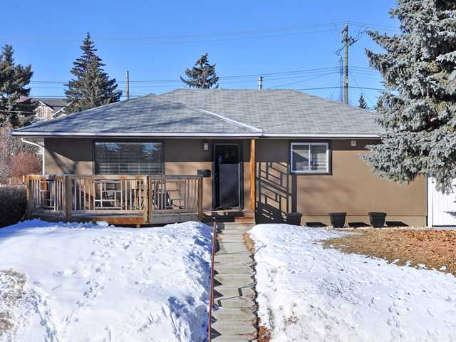 If you have been waiting for a beautiful professionally renovated bungalow on a nice street your wait is over. As you drive up you will notice the exterior has newer stucco & decks. As you enter fall in love with the modern finishings & clever layout. The kitchen is large & features beautiful wood cabinets & raised breakfast bar. The dining area is perfect for family gatherings & has garden doors out to the deck. The master bedroom has a wonderful built in closet, taking advantage of every available space. There is a large second bedroom & a pretty 4 pc bathroom. The fully finished basement is well laid out with a large great room with lots of space for a work out area & home office. There is another renovated full bathroom & generous sized bedroom. There is still plenty of storage, newer furnace & hot water tank. The west facing back yard has beautiful landscaping with a waterfall/pond & a double car garage. There is a gas line to the BBQ area & large deck & patio. This one will not last.