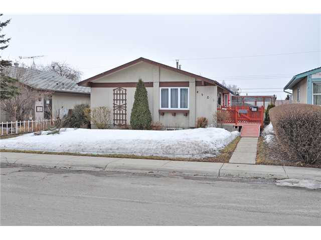 This is a great little home on a beautiful tree lined street close to schools & shopping. If you are trying to get into the Calgary market this a great opportunity. This charming bungalow features a new roof on the home & garage, new doors & windows, counter tops, appliances, updated bathrooms, furnace, hot water tank & air conditioning. As you enter you will appreciate the stunning hardwood floors on the majority of the main level. The living room opens up to the dining area and galley kitchen. The two bedroom on the main floor are a generous size & they share a new beautifully renovated bathroom. Downstairs features new laminate flooring, 2 more bedrooms & another renovated bathroom. Exiting to your sunny south facing backyard you will appreciate the covered patio & wood deck. There is an oversized single garage & extra parking. This gem is a must view.