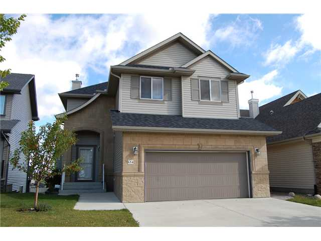 Stunning home backing onto green space & a pond in the desirable community of Coopers!  Welcome to an open & functional main floor plan, with warm hardwood flooring, neutral colors & a built in wall unit in living room, complete with a cozy fireplace. The kitchen, open to the living room with a raised eating bar at the island, hosts granite counter tops, upgraded stainless steel appliances, dark espresso cabinets, & a walk-thru pantry. Upstairs you will find a fabulous Bonus Room for movie nights, a loft/den area, and 3 bedrooms. The master ensuite is gorgeous, with dual sinks, soaker tub & separate shower.  The basement is open for your creative ideas, and is a Walkout to enjoy the view & privacy of the green space! The landscaping, although covered in snow right now, is amazing and includes a stamped concrete pad & stairs, and a gate leading to the wonderful walking paths! Brand new roof & eaves troughs too - this is a really great family home!